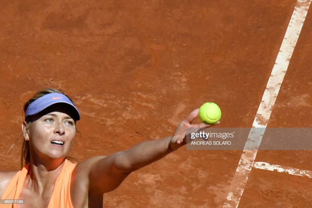 TOPSHOT - Russia's tennis player Maria Sharapova serves against US tennis player Christina McHale during the ATP Tennis Open tournament in Rome at the Foro Italico, on May 15, 2017. /