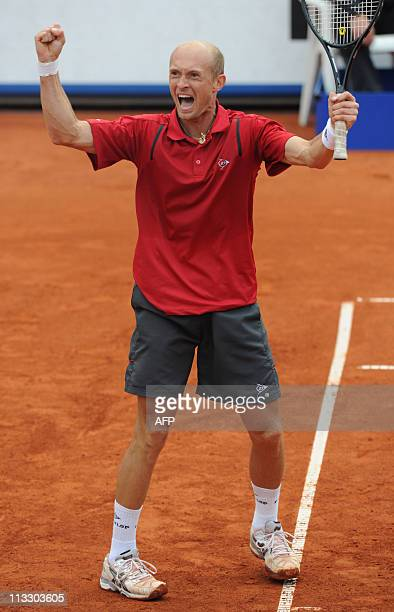 Russia's tennis player Nikolay Davydenko celebrates winning the ATP tennis BMW open final match against Germany's player Florian Mayer in Munich...