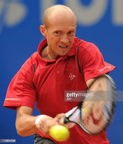 Russia's tennis player Nikolay Davydenko returns the ball to Germany's Florian Mayer during their ATP tennis BMW Open final match in Munich southern...