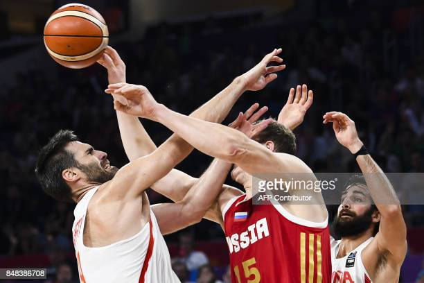 TOPSHOT Russia's Timofey Mozgov vies with Spain's Fernando San Emeterio during the FIBA Euro basket 2017 men's 3rd game match between Spain and...