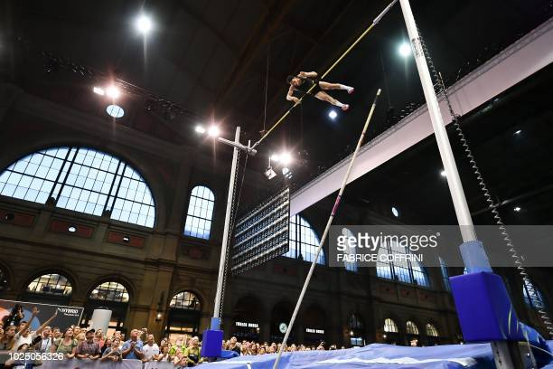 Russia's Timur Morgunov competes to win the men's pole vault event inside Zurich's main railway station during the IAAF Diamond League Athletics...