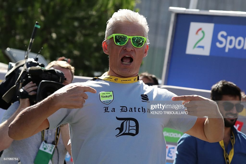 Russia's Tinkoff cycling team owner Oleg Tinkov reacts at the end of the 162,5 km eleventh stage of the 103rd edition of the Tour de France cycling race on July 13, 2016 between Carcassonne and Montpellier. / AFP / KENZO