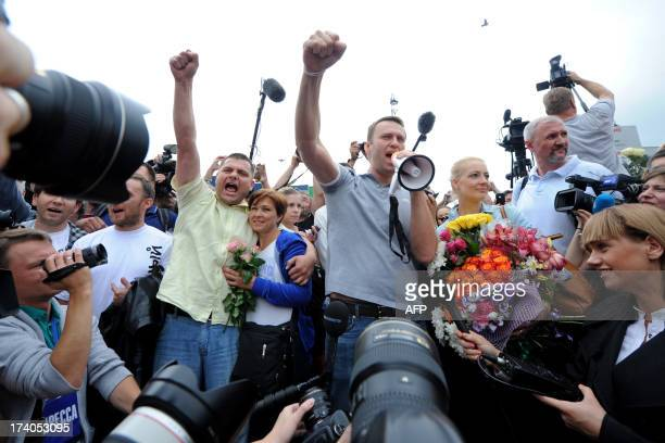 Russia's top opposition leader Alexei Navalny addresses supporters and journalists next to and his former colleague Pyotr Ofitserov upon his arrival...