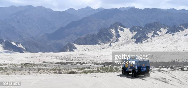 Russia's truck driver Eduard Nikolaev and codrivers Evgeny Iakolev and Vladimir Rybakov compete during the Stage 11 of the 2018 Dakar Rally between...