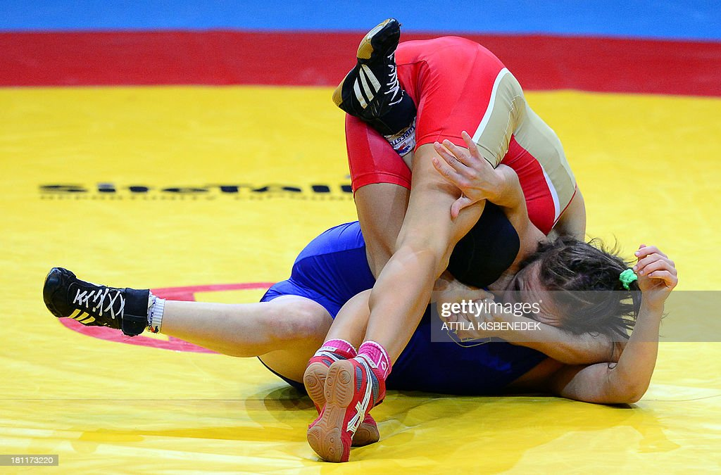 Russia's Valeriia Koblova (red) and Ukraine's Iryna Husyak (blue) fight during the women's free style 55 kg category for bronze of the FILA World Wrestling Championships in Budapest on September 19, 2013. Koblova won te bronze medal.