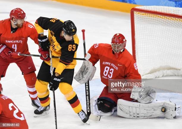 Russia's Vasili Koshechkin blocks a shot in the men's gold medal ice hockey match between the Olympic Athletes from Russia and Germany during the...