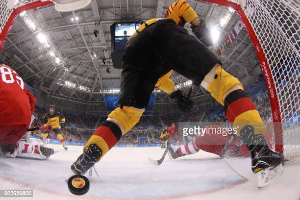 TOPSHOT Russia's Vasili Koshechkin lets in a goal by Germany's Felix Schutz in the men's gold medal ice hockey match between the Olympic Athletes...