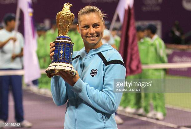 Russia's Vera Zvonareva poses with her trophy after beating Denmark's Caroline Wozniacki in their Qatar WTA Tennis Open final tennis match in Doha on...