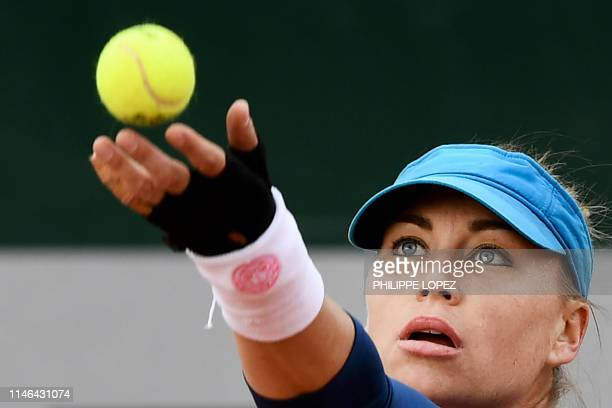 Russia's Vera Zvonareva serves the ball to Spain's Aliona Bolsova Zadoinov during their women's singles first round match on day two of The Roland...
