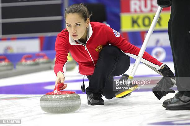 Russia's viceskip Anastasia Bryzgalova delivers a stone during semifinals the game between Russia and Korea within the World Mixed Curling...