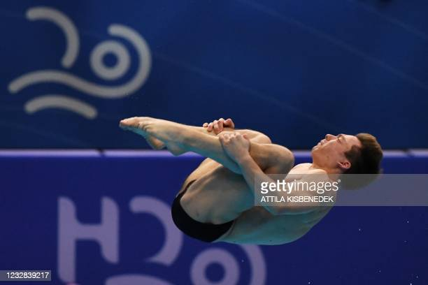 Russia's Victor Povzner competes in the preliminary for the Men's 1m Springboard Diving event during the LEN European Aquatics Championships at the...
