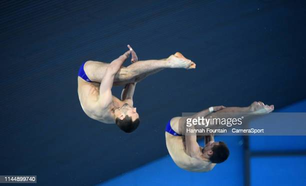 Russia's Viktor Minibaev and Aleksandr Bondar compete in the Men's 10m Synchro Platform during Day 1 of the FINA/CNSG Diving World Series 2019 at...