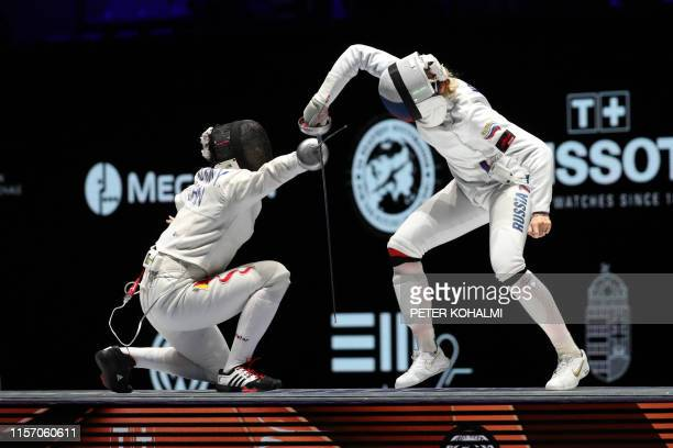 Russia's Violetta Kolobova and Chinas Zhu Mingye compete in the Women's Epee Team event at the 2019 Fencing World Championships in Budapest Hungary...