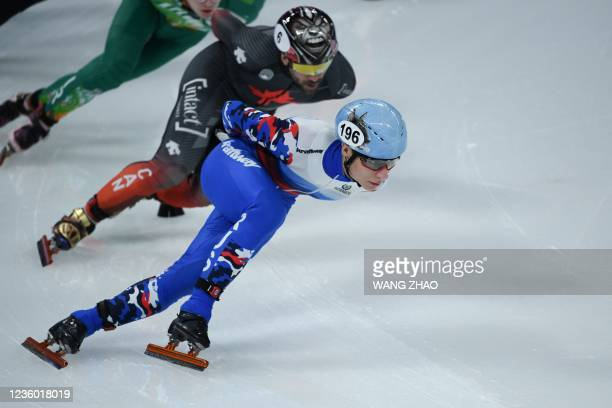 Russia's Vladimir Balbekov competes in the men's 1500m quarter finals during the 2021/2022 ISU World Cup short track speed skating, part of a 2022...