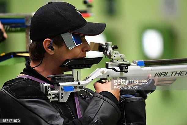 Russia's Vladimir Maslennikov competes during the 10m Air Rifle Men's at the Olympic Shooting Centre in Rio de Janeiro on August 8 during the Rio...
