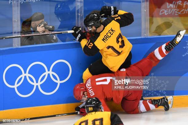 Russia's Vladislav Gavrikov and Germany's Brooks Macek collide in the men's gold medal ice hockey match between the Olympic Athletes from Russia and...