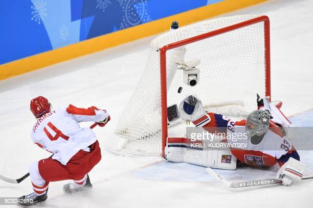 Russia's Vladislav Gavrikov scores against Czech Republic's Pavel Francouz in the men's semifinal ice hockey match between the Czech Republic and the...
