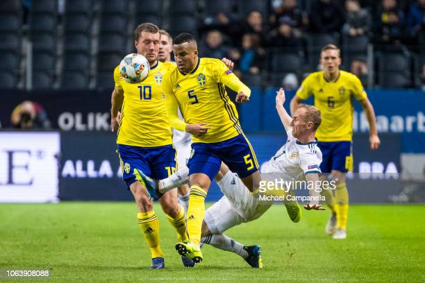 Russia's Vladislav Ignatyev fails to strip Sweden's Martin Olsson of the ball during the UEFA Nations League B group two match between Sweden and...