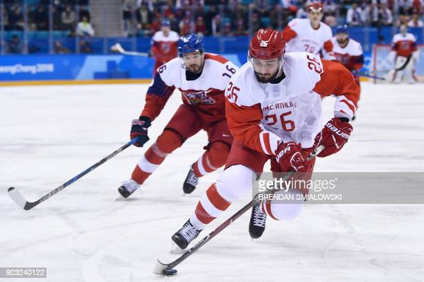 TOPSHOT Russia's Vyacheslav Voinov controls the puck in front of Czech Republic's Michal Birner in the men's semifinal ice hockey match between the...