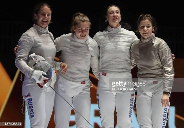 Russia's Yana Egorian Russia's Sofia Pozdniakova Russia's Olga Nikitina and Russia's Sofya Velikaya celebrate after the Women's Sabre team final at...