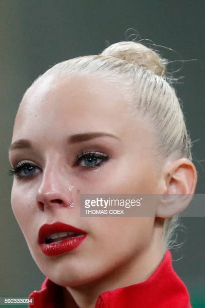 Russia's Yana Kudryavtseva reacts after competing in the individual allaround final event of the Rhythmic Gymnastics at the Olympic Arena during the...