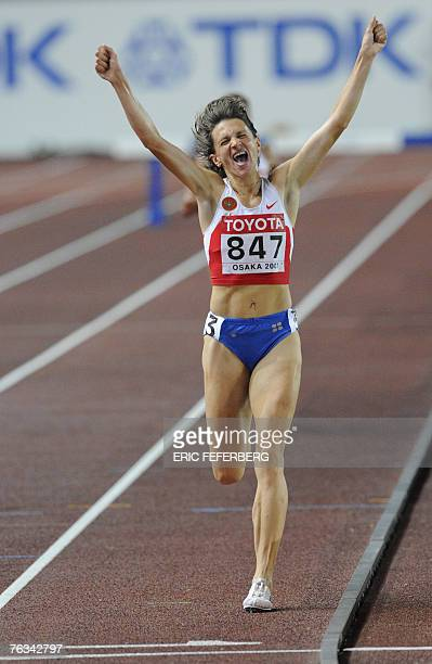 Russia's Yekaterina Volkova celebrates after winning the women's 3000m steeplechase final 27 August 2007 at the 11th IAAF World Athletics...