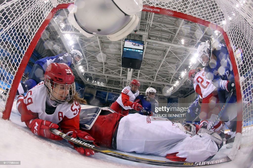 Russia's Yelena Dergachyova (L) and Russia's Valeria Tarakanova defend their goal in the women's preliminary round ice hockey match between the US and Olympic Athletes from Russia during the Pyeongchang 2018 Winter Olympic Games at the Kwandong Hockey Centre in Gangneung on February 13, 2018. / AFP PHOTO / POOL / Bruce Bennett