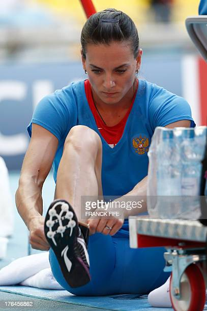 Russia's Yelena Isinbayeva preapres to compete in the women's pole vault final at the 2013 IAAF World Championships at the Luzhniki stadium in Moscow...