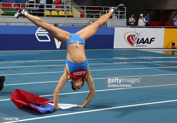 Russia's Yelena Isinbayeva somersaults after winning the women's pole vault final at the 2013 IAAF World Championships at the Luzhniki stadium in...