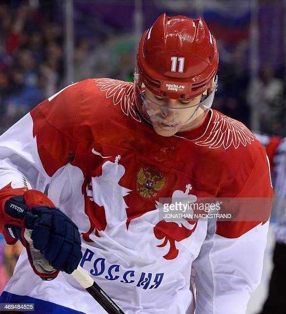 Russia's Yevgeni Malkin reacts after missing during penelty shootout at the end of the Men's Ice Hockey Group A match USA vs Russia at the Bolshoy...