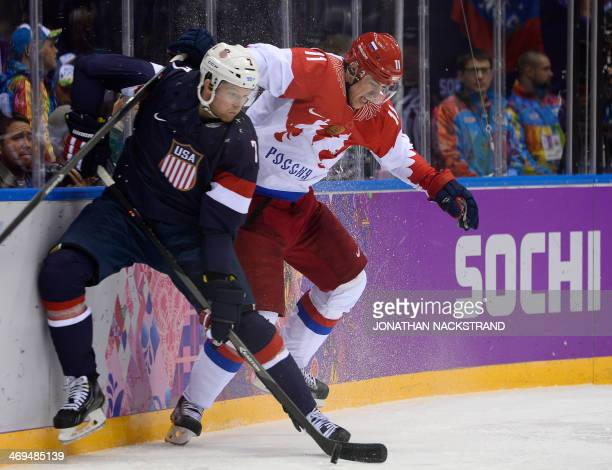 Russia's Yevgeni Malkin vies US Paul Martin during the Men's Ice Hockey Group A match USA vs Russia at the Bolshoy Ice Dome during the Sochi Winter...
