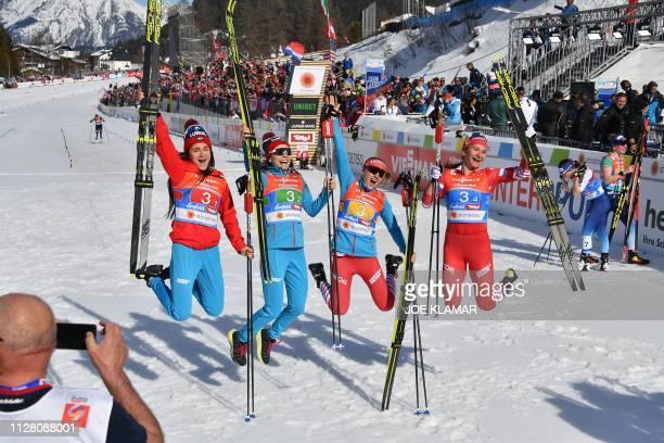 Russia's Yulia Belorukova Russia's Anastasia Sedova Russia's Anna Nechaevskaya and Russia's Natalia Nepryaeva pose after finishing third in the...