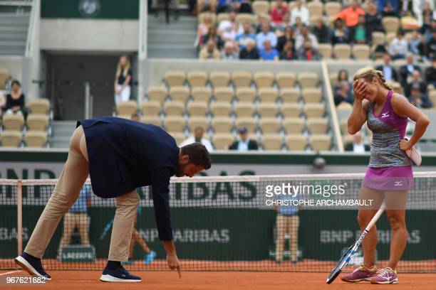 Russia's Yulia Putintseva looks on as the umpire points out a line call during her women's singles quarter-final match against Madison Keys of the US...