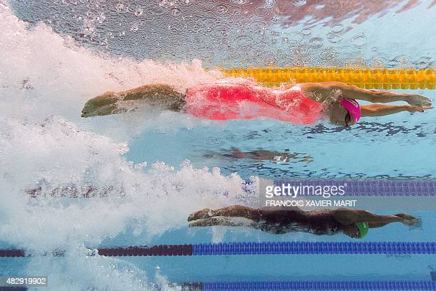 CAMERA Russia's Yuliya Efimova and Jamaica's Alia Atkinson compete in the final of the women's 100m breaststroke swimming event at the 2015 FINA...