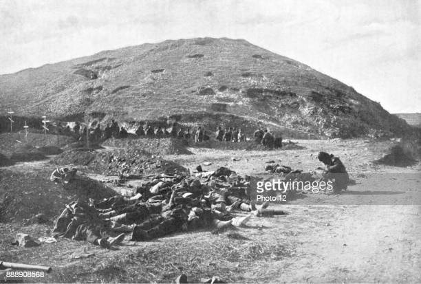 Russo-Japanese War 1904-1905 203 Metre Hill on the day of its capture by the Japanese. Russian soldiers collecting cartridges from the dead before...
