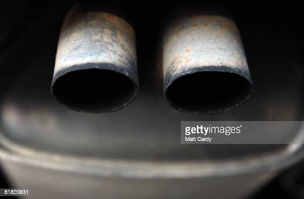 Rust spots gather on the exhaust pipe of a second hand car for sale parked on a used car lot on July 4 2008 in Bristol England The value of second...