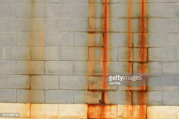 Rust stains on a brick wall