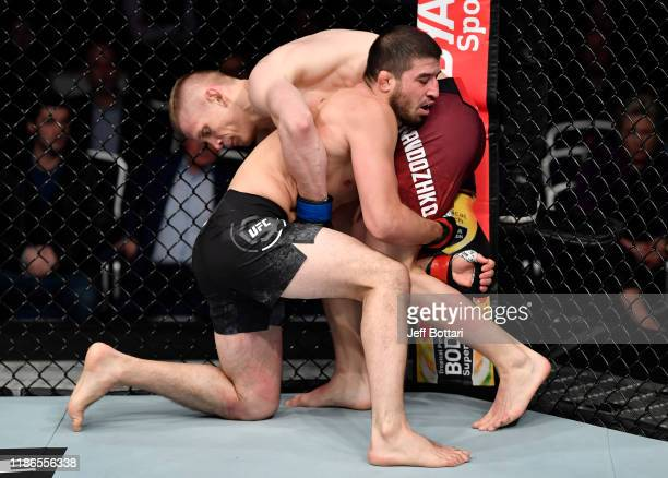 Rustam Khabilov of Russia attempts to take down Sergey Khandozhko of Russia in their welterweight bout during the UFC Fight Night event at CSKA Arena...