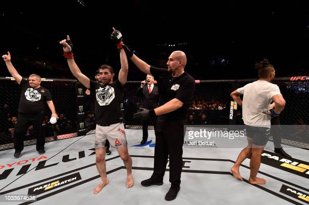 Rustam Khabilov of Russia celebrates his victory over Kajan Johnson of Canada after their lightweight bout during the UFC Fight Night event at...