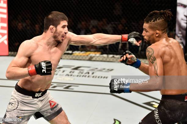 Rustam Khabilov of Russia punches Kajan Johnson of Canada in their lightweight bout during the UFC Fight Night event at Olimpiysky Arena on September...