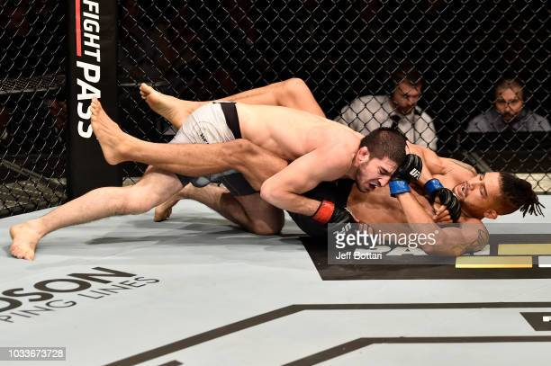 Rustam Khabilov of Russia takes down Kajan Johnson of Canada in their lightweight bout during the UFC Fight Night event at Olimpiysky Arena on...