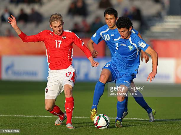 Rustamjon Ashurmatov of Uzbekistan turns from Konrad Laimer of Austria during the FIFA U20 World Cup round of 16 match between Austria and Uzbekistan...