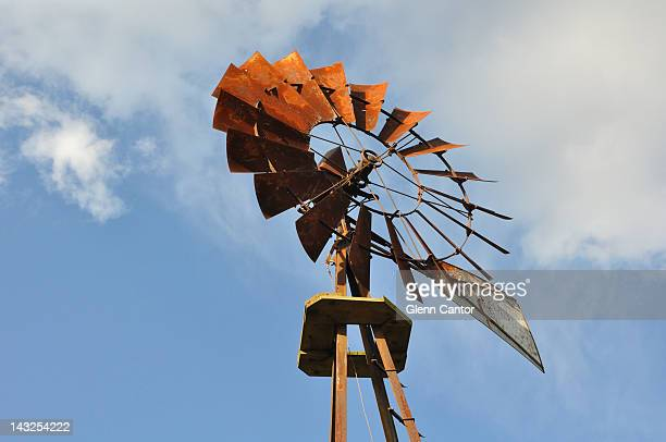 rusted and broken farm windmill - traditional windmill stock photos and pictures