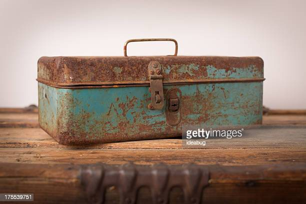 Rusted Antique Toolbox, Sitting on Wood Trunk