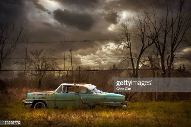 rusted car in dilapidated urban field - absence stock pictures, royalty-free photos & images