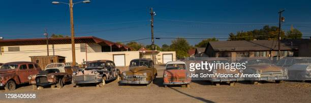 Rusted cars in a car lot Delta, Colorado.