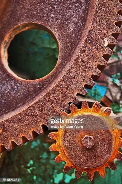 Rusted cogs interlocking close-up