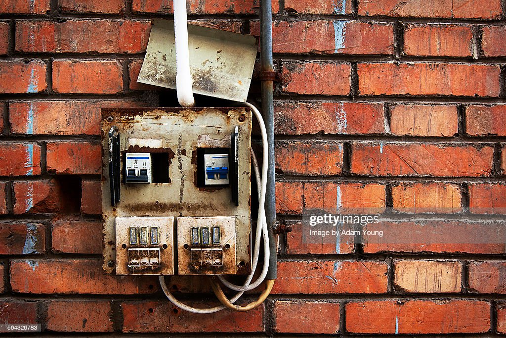 Rusted electricity box in disrepair : Stock Photo