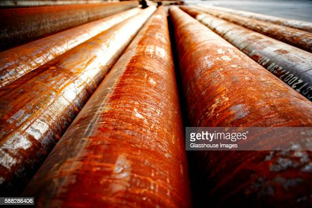 rusted industrial metal pipes, close up - rusty stock pictures, royalty-free photos & images