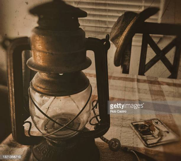 rusted kerosene lamp - rob castro stock pictures, royalty-free photos & images